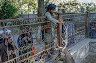 Scores of armed Taliban fighters -- and many more without weapons -- walked into the zoo after Friday prayers (AFP/BULENT KILIC)