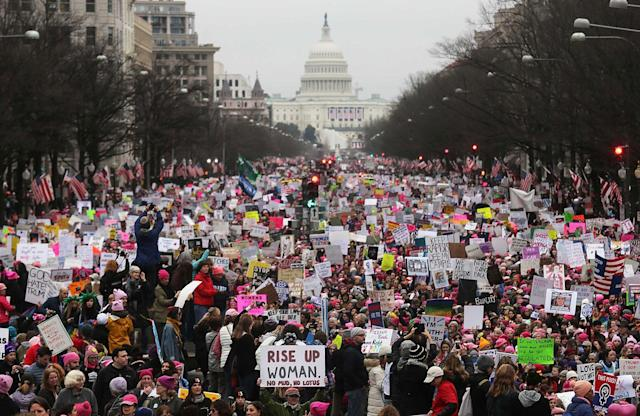 <p>JAN. 21, 2017 – Protesters walk during the Women's March on Washington. Large crowds are attending the anti-Trump rally a day after U.S. President Donald Trump was sworn in as the 45th U.S. president. (Photo: Mario Tama/Getty Images) </p>
