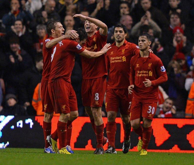 Liverpool's Steven Gerrard (C) celebrates with Stewart Downing (2nd L) and teammates after scoring on December 22, 2012