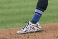 St. Louis Cardinals starting pitcher Jack Flaherty (22) wears cleats supporting the Black Lives Matter movement during the first inning of a baseball game against the Cleveland Indians, Saturday, Augf. 29, 2020, in St. Louis. (AP Photo/Scott Kane)