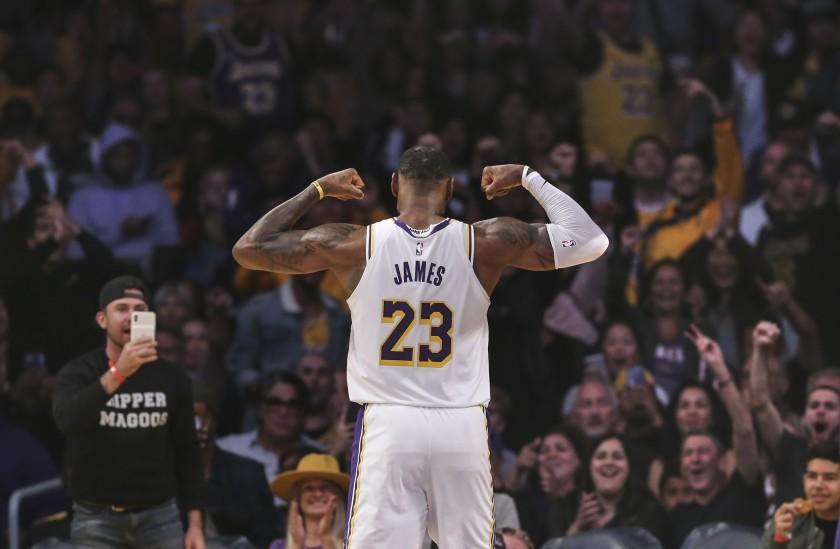LeBron James flexes for the crowd during a game against the Hornets on Oct. 27 at Staples Center.