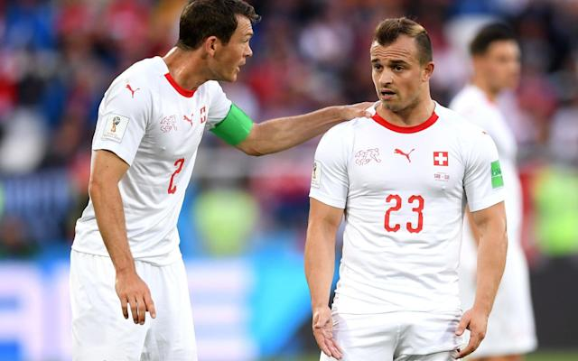 Stephan Lichtsteiner (left), the Swiss captain, will face disciplinary proceedings alongside Xherdan Shaqiri (right) and Granit Xhaka following Friday night's heated meeting between Switzerland and Serbia - Getty Images Europe