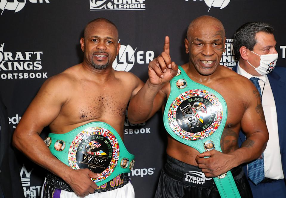 LOS ANGELES, CALIFORNIA - NOVEMBER 28: Roy Jones Jr. (L) and Mike Tyson celebrate their split draw during Mike Tyson vs Roy Jones Jr. presented by Triller at Staples Center on November 28, 2020 in Los Angeles, California. (Photo by Joe Scarnici/Getty Images for Triller)