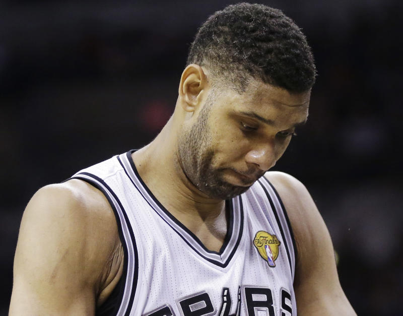 San Antonio Spurs forward Tim Duncan pauses between plays against the Miami Heat during the first half in Game 2 of the NBA basketball finals on Sunday, June 8, 2014, in San Antonio. Miami won 98-96