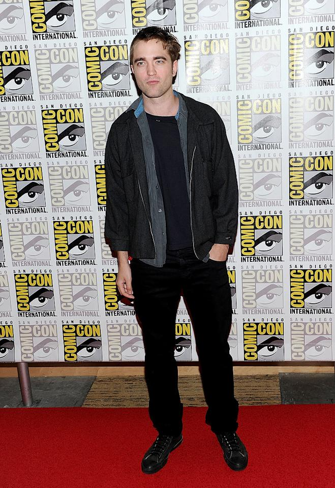 """Kristen's on-screen love and real-life boyfriend, Robert Pattinson, followed closely behind, sporting an interesting new 'do. But don't worry, folks ... his semi-buzz cut is for a movie he's filming called """"Cosmopolis."""" Michael Buckner/<a href=""""http://www.gettyimages.com/"""" target=""""new"""">GettyImages.com</a> - July 21, 2011"""