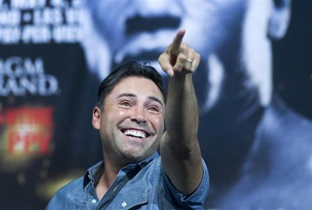 Oscar De La Hoya points towards the crowd before an official weigh-in for WBC welterweight champion Floyd Mayweather Jr. and Robert Guerrero at the MGM Grand Garden Arena in Las Vegas