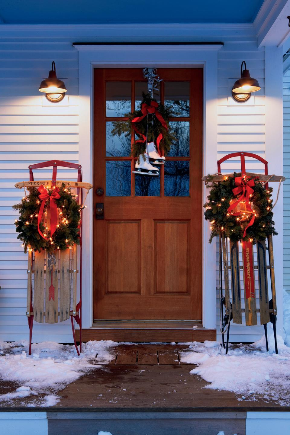 <p>The principle of symmetry can work beautifully for your Christmas door decor. Hang an ice skate wreath on your front door, along with pre-lit wreaths on either side for a picture-perfect look. </p>
