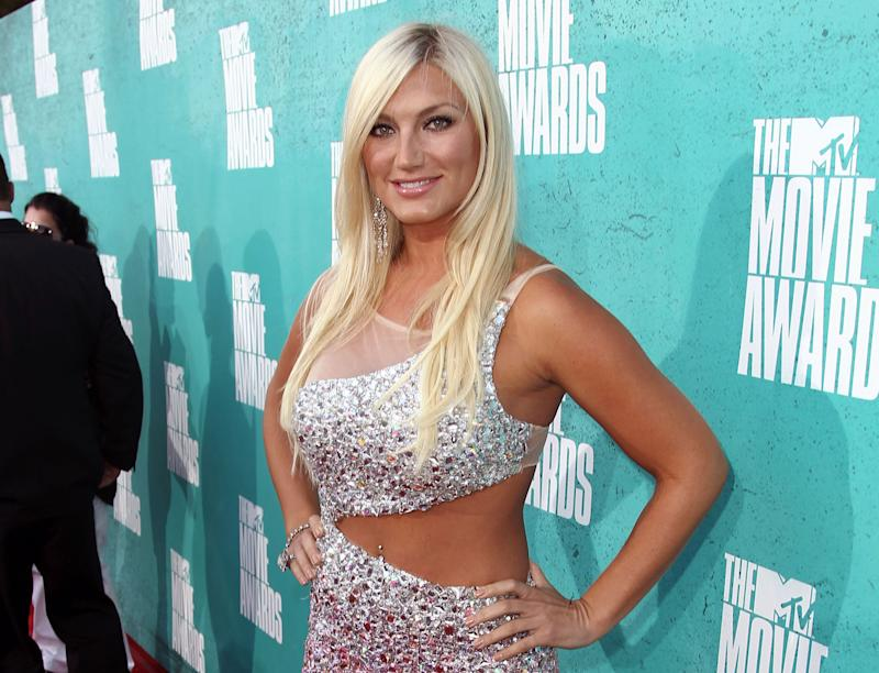 FILE - In this June 3, 2012 file photo, TV personality Brooke Hogan arrives at the MTV Movie Awards in Los Angeles. Hogan, the daughter of wrestler Hulk Hogan, is engaged to Dallas Cowboys offensive lineman Phil Costa. The former reality TV star and recording artist announced on Instagram that Costa proposed over the weekend in Las Vegas. Costa's agent, George Mavrikes, confirmed the engagement Monday, July 1, 2013. (Photo by Matt Sayles/Invision/AP, File)