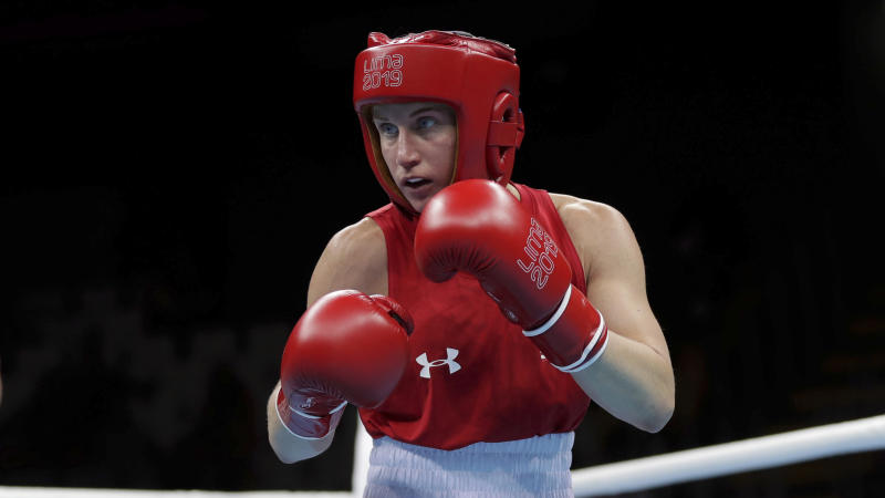 Virginia Fuchs of United States competes against Irismar Cardozo of Venezuela during the first round of their women's fly, 51 kg, boxing semifinal match at the Pan American Games in Lima, Peru, Tuesday, July 30, 2019. (AP Photo/Fernando Llano)