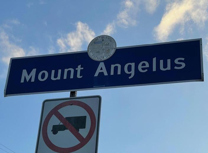 A blue and white neighborhood sign for Mount Angelus in northeast L.A.