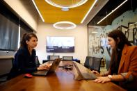 Neta Schreiber, CEO and Co-Founder at SafeUP, a women's safety net application, works with her team member at a co-working space in Tel Aviv