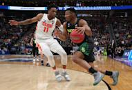 <p>King McClure #3 of the Baylor Bears drives against Oshae Brissett #11 of the Syracuse Orange during the first half in the first round of the 2019 NCAA Men's Basketball Tournament at Vivint Smart Home Arena on March 21, 2019 in Salt Lake City, Utah. </p>