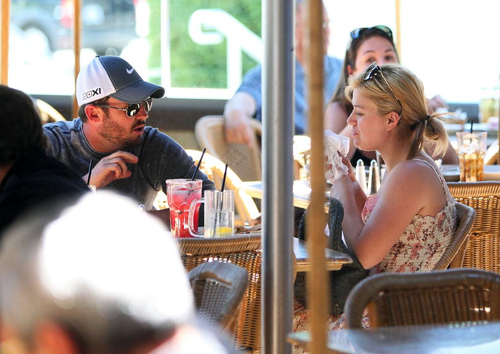 "Kelly Clarkson, 30, had lunch with boyfriend Brandon Blackstock, 35, at The Cheesecake Factory in Sherman Oaks, California, on Monday. The ""Stronger"" singer's been dating Blackstock, the son of Clarkson's manager Narvel Blackstock and stepson of mentor Reba McEntire, since late last year. (6/25/2012)"