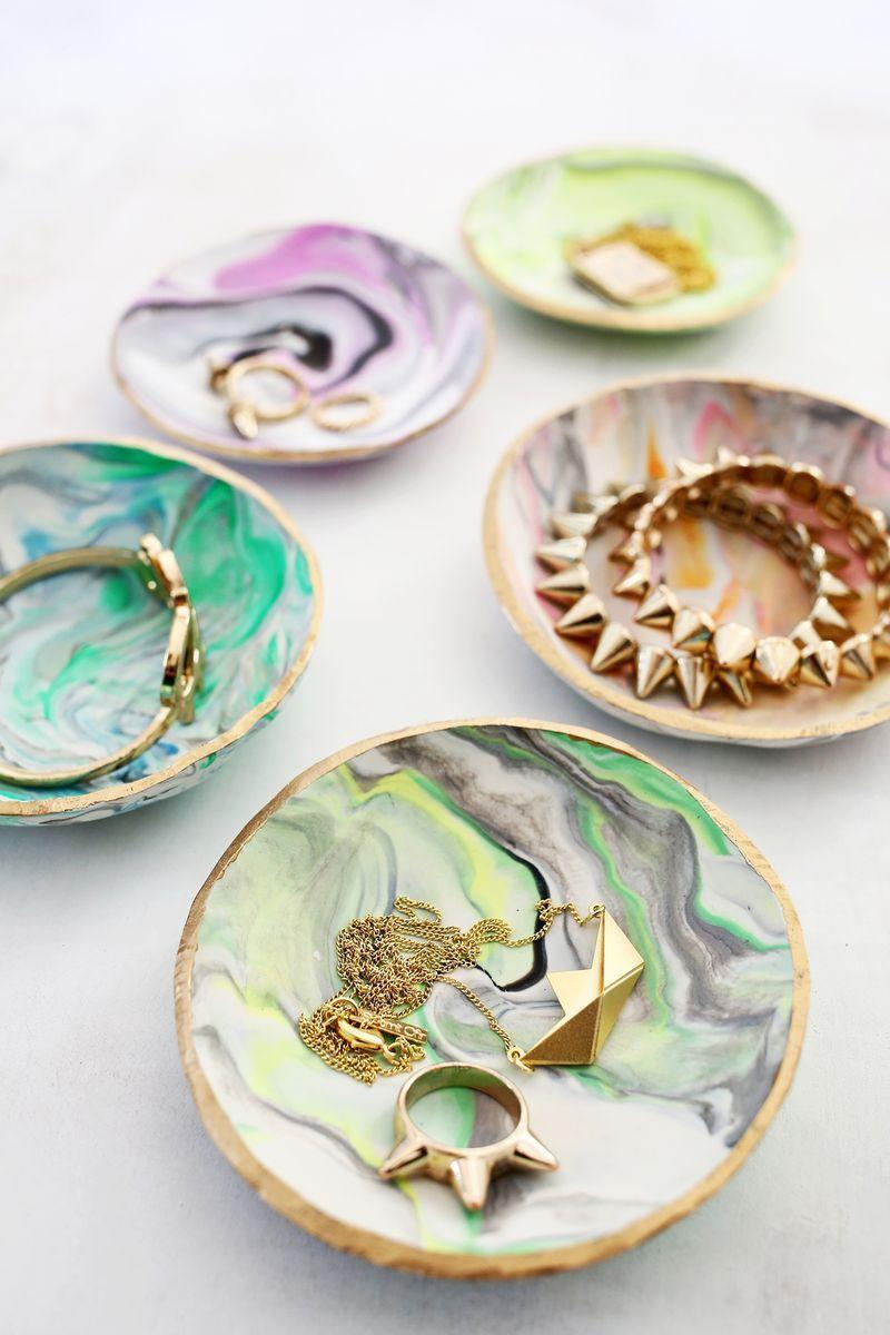 """<p>These ring dishes are so pretty, you'll want to make at least two for yourself.</p><p><em><strong>Get the tutorial from <a href=""""https://abeautifulmess.com/2014/11/marbled-clay-ring-dish.html"""" rel=""""nofollow noopener"""" target=""""_blank"""" data-ylk=""""slk:A Beautiful Mess"""" class=""""link rapid-noclick-resp"""">A Beautiful Mess</a>.</strong></em> </p><p><strong><a class=""""link rapid-noclick-resp"""" href=""""https://www.amazon.com/gp/slredirect/picassoRedirect.html/ref=pa_sp_atf_aps_sr_pg1_1?ie=UTF8&adId=A10401302LZJVIJPIVWGY&url=%2FPolymer-Starter-Oven-Bake-Sculpting-Accessories%2Fdp%2FB07B9ZXK6C%2Fref%3Dsr_1_1_sspa%3Fdchild%3D1%26keywords%3DOVEN%2BBAKE%2BCLAY%26qid%3D1605822366%26sr%3D8-1-spons%26psc%3D1&qualifier=1605822366&id=4828628204498229&widgetName=sp_atf&tag=syn-yahoo-20&ascsubtag=%5Bartid%7C10063.g.34832092%5Bsrc%7Cyahoo-us"""" rel=""""nofollow noopener"""" target=""""_blank"""" data-ylk=""""slk:SHOP CLAY"""">SHOP CLAY</a></strong></p>"""