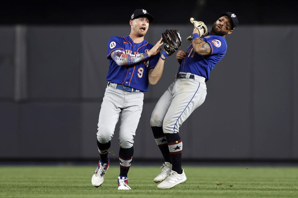 New York Mets center fielder Brandon Nimmo (9) makes a catch on a fly out by New York Yankees designated hitter Giancarlo Stanton in front of right fielder Kevin Pillar during the sixth inning of the second baseball game of a doubleheader, Sunday, July 4, 2021, in New York. (AP Photo/Adam Hunger)