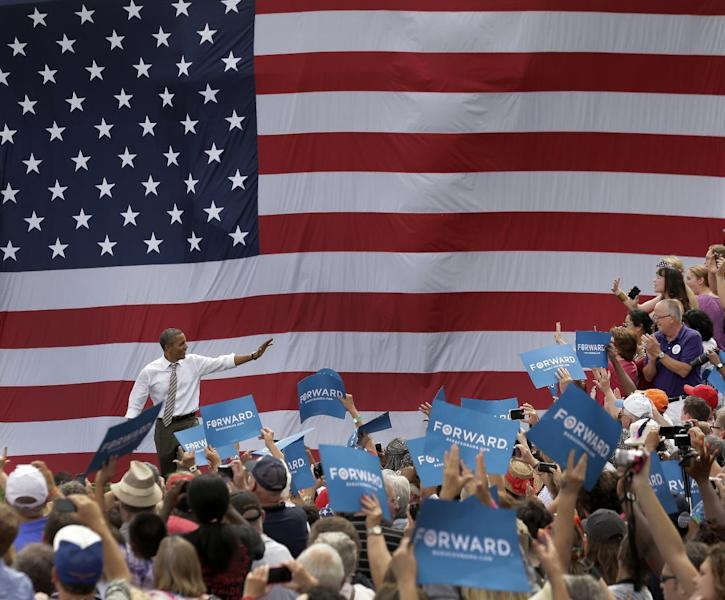 President Barack Obama arrives at a campaign stop at the Living History Farms, Saturday, Sept. 1, 2012, in Des Moines, Iowa. (AP Photo/Charlie Riedel)