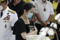 Ballsy Aquino-Cruz, embraces the urn of her brother former Philippine President Benigno Aquino III before he is placed in the tomb during state burial rites on Saturday, June 26, 2021 at a memorial park in suburban Paranaque city, Philippines. Aquino was buried in austere state rites during the pandemic Saturday with many remembering him for standing up to China over territorial disputes, striking a peace deal with Muslim guerrillas and defending democracy in a Southeast Asian nation where his parents helped topple a dictator. He was 61. (AP Photo/Aaron Favila)