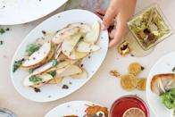 """Crisp, fresh shaved apples get a savory kick and an appealing crunchy texture when you top them with toasted mustard seeds. <a href=""""https://www.epicurious.com/recipes/food/views/apple-salad-with-toasted-mustard-seeds-and-herbs?mbid=synd_yahoo_rss"""" rel=""""nofollow noopener"""" target=""""_blank"""" data-ylk=""""slk:See recipe."""" class=""""link rapid-noclick-resp"""">See recipe.</a>"""