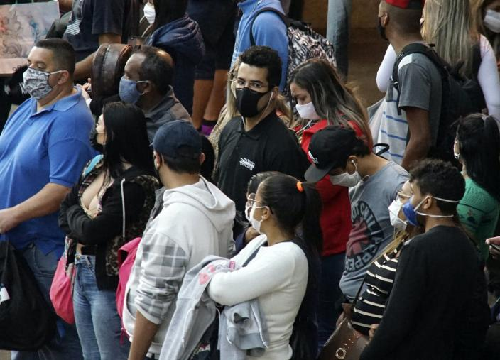 "<span class=""caption"">A few people in the crowd will be responsible for the bulk of a disease's spread.</span> <span class=""attribution""><a class=""link rapid-noclick-resp"" href=""https://www.gettyimages.com/detail/news-photo/commuters-wearing-protective-masks-wait-for-a-train-at-the-news-photo/1215807811"" rel=""nofollow noopener"" target=""_blank"" data-ylk=""slk:Pacific Press /LightRocket via Getty Images"">Pacific Press /LightRocket via Getty Images</a></span>"