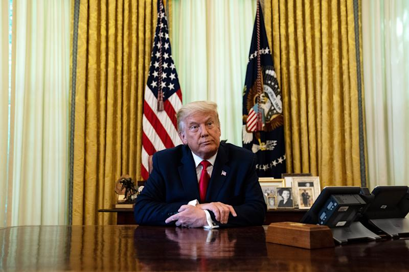 WASHINGTON, DC - AUGUST 28: U.S. President Donald Trump listens during an event in the Oval Office of the White House August 28, 2020 in Washington, DC. President Trump has officially pardoned former federal prisoner Alice Johnson, who was sentenced to life for cocaine trafficking in 1997 and recently received a commutation from the President in 2018. (Photo by Anna Moneymaker/Pool/Getty Images)