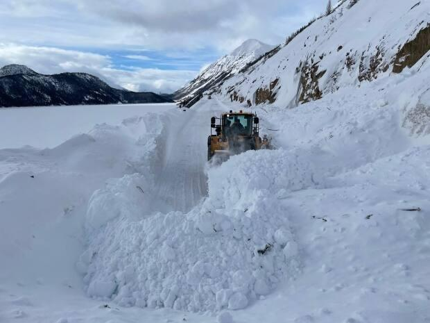 A snowplow clears a path on the South Klondike Highway. On Tuesday, the highway was shut down. (Colin MacKenzie - image credit)