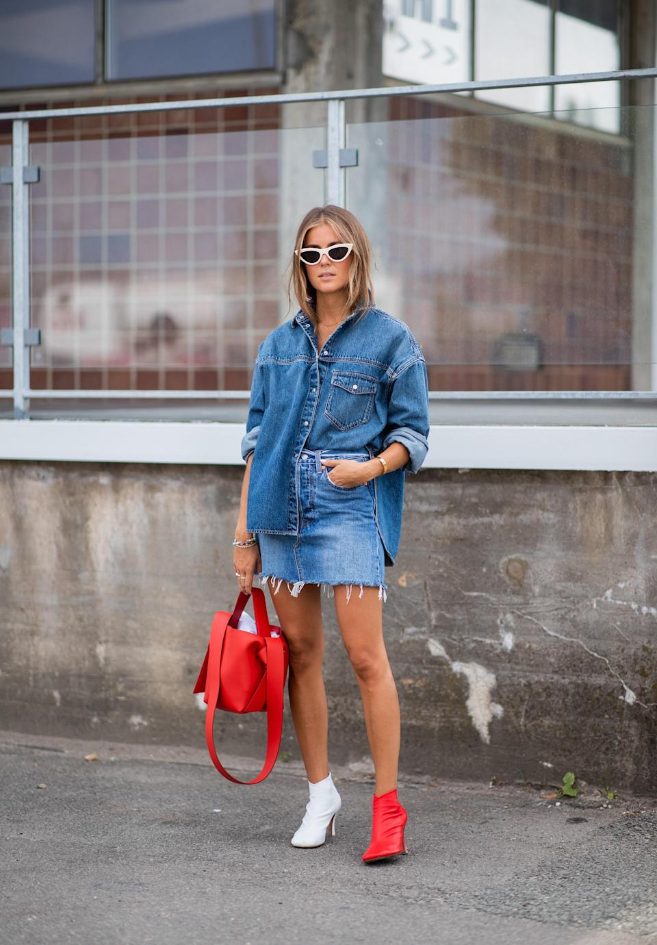 Pair an oversized denim skirt with a denim miniskirt. Mismatched boots entirely optional.