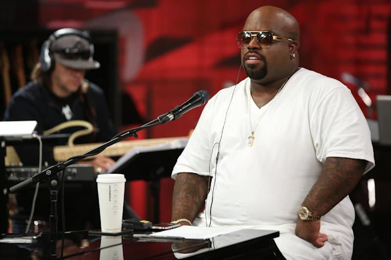 "This image released by NBC shows CeeLo Green from the singing competition series ""The Voice,"" during a mentoring session in Los Angeles that aired on Oct. 8, 2012. NBC is shelling out big for attention-grabbing scripted series and for premiere sports events and shows like ""The Voice"" that invite live viewing to overcome ad skipping.  (AP Photo/NBC, Tyler Golden)"