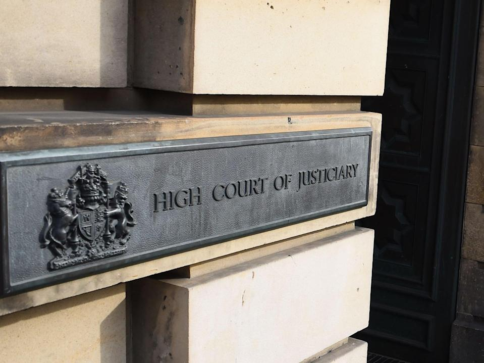 <p>The trial is ongoing at the High Court in Edinburgh</p> (AFP via Getty Images)