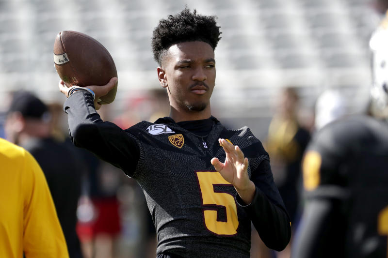 Arizona State quarterback Jayden Daniels (5) warms up his teammates prior to an NCAA college football game against Southern California, Saturday, Nov. 9, 2019, in Tempe, Ariz. Daniels did not suit up due to an injury. (AP Photo/Matt York)