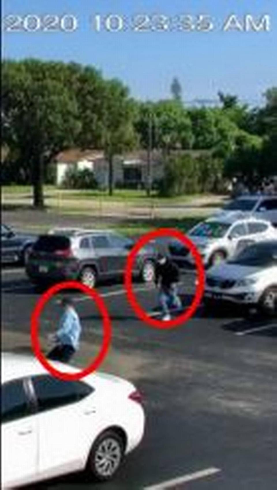 A surveillance video still spots the first two would-be armed robbers at the Castle Apartments, Oct. 13.