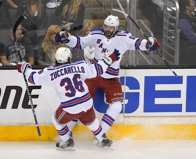 New York Rangers left wing Benoit Pouliot, right, celebrates his goal with right wing Mats Zuccarello, of Norway, against the Los Angeles Kings during the first period in Game 1 of the NHL hockey Stanley Cup Finals, Wednesday, June 4, 2014, in Los Angeles. (AP Photo/Mark J. Terrill)