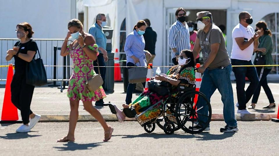 People leave the Miami Dade College North vaccination site where the second dose of the Pfizer-BioNTech COVID-19 vaccine is available in Miami on Tuesday, April 13, 2021.