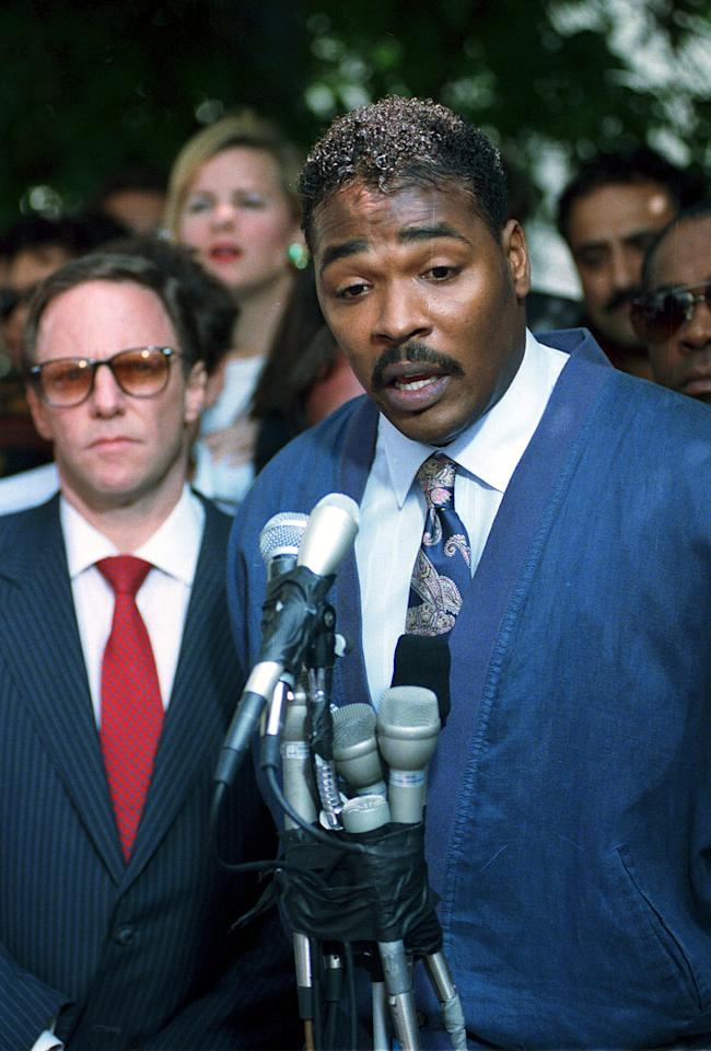 FILE - In this May 1,1992 file photo Rodney King, right, makes his first statement, pleading for an end to the rioting in South Central Los Angeles, in Los Angeles. At left is King's attorney Steven Lerman. On April 29, 1992, four white police officers were declared innocent in the beating of black motorist Rodney King, and Los Angeles erupted in the deadliest riots of the century. (AP Photo/David Longstreath,File)