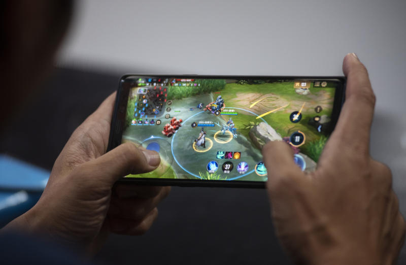 HONG KONG, CHINA - 2019/07/28: A competitor plays mobile game during the E-Sports and Music Festival Hong Kong. (Photo by Budrul Chukrut/SOPA Images/LightRocket via Getty Images)