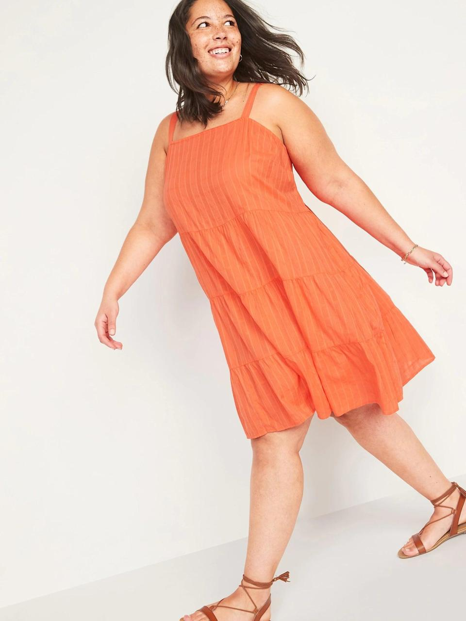 <p>This <span>Old Navy Sleeveless Tiered Dobby Plus-Size Swing Dress</span> ($38) makes a bright and cheerful addition to your summer closet.</p>