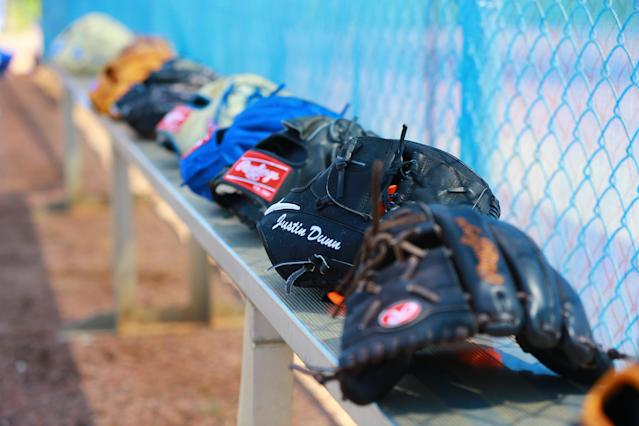 <p>The gloves of New York Mets minor league pitchers sit on the bench at the Mets' minor league complex in Port St. Lucie, Fla., March 2, 2018. (Photo: Gordon Donovan/Yahoo News) </p>