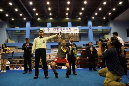 Huang Wensi celebrates her victory after the referee awards her a technical knock-out during the seventh round in her fight against Thailand's Jarusiri Rongmuang for the Asia Female Continental Super Flyweight Championship gold belt in Taipei, Taiwan, September 26, 2018. REUTERS/Yue Wu