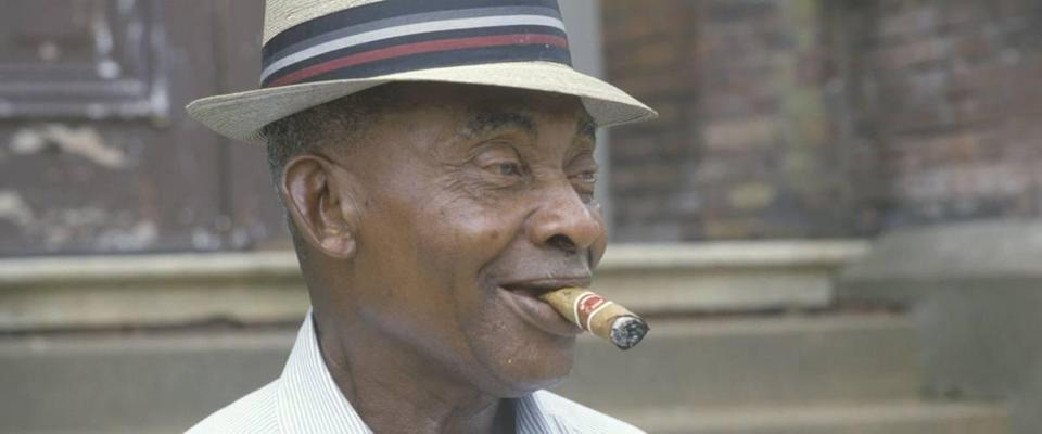 An African-American man smoking a cigar, Vicksburg, MS