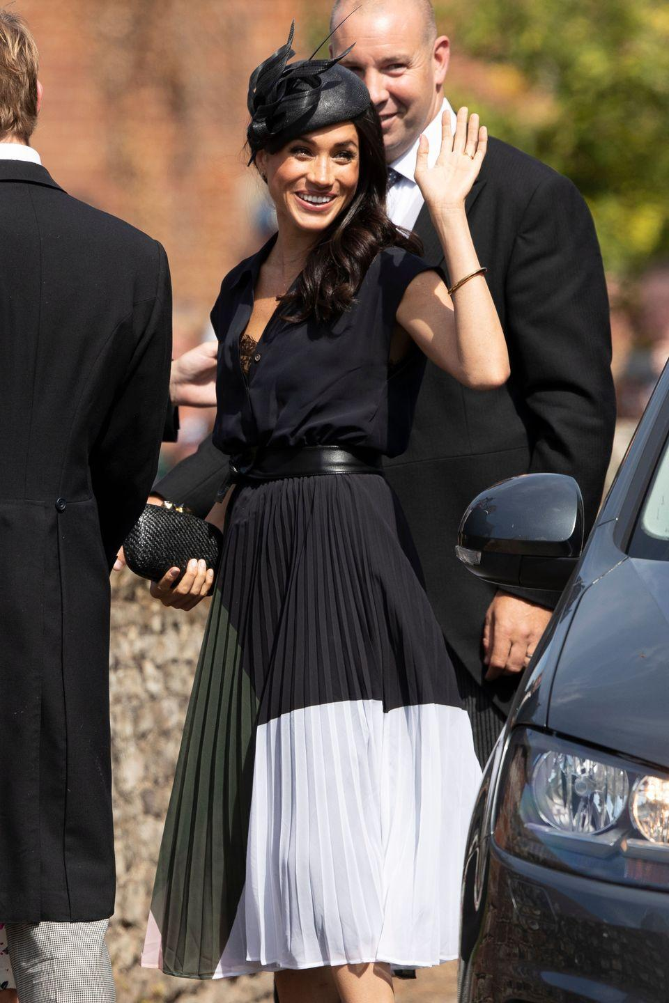 "<p>Meghan celebrated her birthday (and Charlie van Straubenzee's wedding) in a colorful dress paired with a Philip Treacy fascinator. <a href=""https://www.townandcountrymag.com/style/fashion-trends/a22639732/meghan-markle-colorful-navy-dress-charlie-van-straubenzee-wedding/"" rel=""nofollow noopener"" target=""_blank"" data-ylk=""slk:Get all the details right here."" class=""link rapid-noclick-resp"">Get all the details right here.</a></p>"
