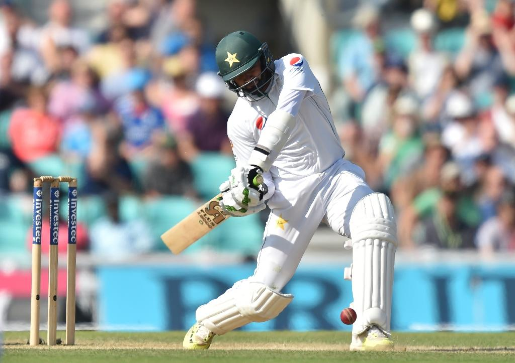 Pakistan's Azhar Ali hits a six, the winning runs during play on the fourth day of the fourth test cricket match between England and Pakistan at the Oval in London on August 14, 2016 (AFP Photo/Olly Greenwood)