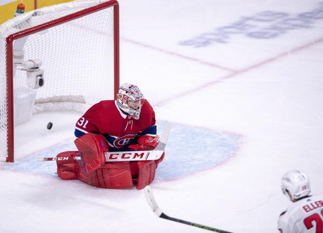 Washington Capitals centre Lars Eller (20) scores the winning goal against Montreal Canadiens goaltender Carey Price (31) during the overtime period in NHL hockey action Monday, Nov. 19, 2018 in Montreal. (Ryan Remiorz/The Canadian Press via AP)