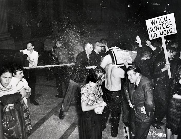 Police hose demonstrators in San Francisco's city hall who are protesting against the House Committee on Un-American Activities. The riot ended with police dragging the protesters from the building. May 13, 1960. (Photo: Bettmann Archive/Getty Images)