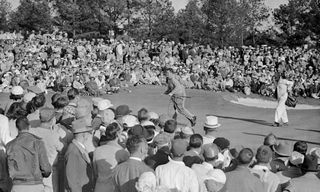 "<span class=""element-image__caption"">Jack Burke Jr, centre, sprints across the 18th green at Augusta after sinking his final putt in 1956.</span> <span class=""element-image__credit"">Photograph: Horace Cort/AP</span>"