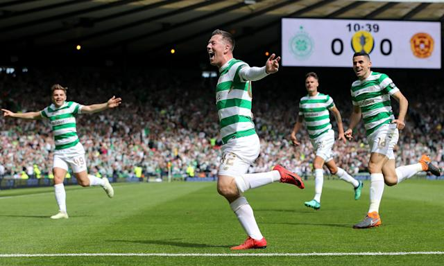 Callum McGregor runs off to celebrate after scoring Celtic's first goal on their way to victory over Motherwell in the Scottish Cup final at Hampden Park.