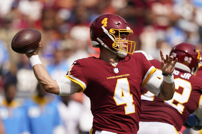 Washington Football Team quarterback Taylor Heinicke (4) throws the ball against the Los Angeles Chargers during the first half of an NFL football game, Sunday, Sept. 12, 2021, in Landover, Md. (AP Photo/Andrew Harnik)