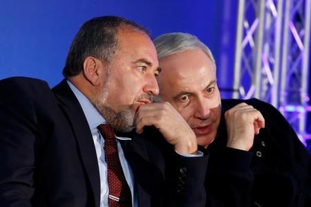 FILE PHOTO: Israel's Prime Minister Netanyahu converses with former Foreign Minister Lieberman during a campaign rally in Ashdod
