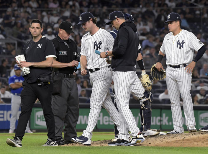New York Yankees pitcher Gerrit Cole, center, leaves during the fourth inning of the team's baseball game against the Toronto Blue Jays on Tuesday, Sept. 7, 2021, at Yankee Stadium in New York. (AP Photo/Bill Kostroun)