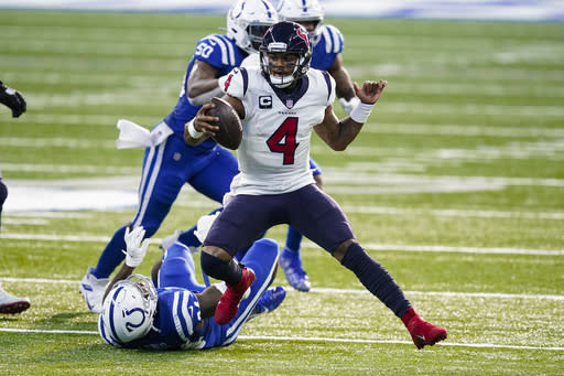 Houston Texans quarterback Deshaun Watson (4) runs against the Indianapolis Colts in the second half of an NFL football game in Indianapolis, Sunday, Dec. 20, 2020. (AP Photo/Darron Cummings)