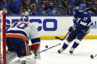 Tampa Bay Lightning left wing Alex Killorn (17) flips a shot on New York Islanders goaltender Semyon Varlamov (40) during the second period in Game 1 of an NHL hockey Stanley Cup semifinal playoff series Sunday, June 13, 2021, in Tampa, Fla. (AP Photo/Chris O'Meara)