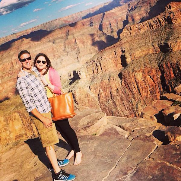In this Oct. 21, 2014 photo provided by TheBrittanyFund.org, Brittany Maynard and her husband Dan Diaz pose at the Grand Canyon National Park in Arizona. The 29-year-old terminally ill woman has fulfilled a wish on her bucket list: visiting the Grand Canyon. Maynard, who has advanced brain cancer, has said she plans use Oregon's death-with-dignity law to end her own life Saturday, Nov. 1, 2014 though she could still change her mind. Maynard and her husband moved to Oregon from Northern California because Oregon allows terminally ill patients to end their lives with lethal medications prescribed by a doctor. (AP Photo/TheBrittanyFund.org)